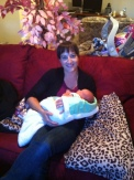 A postpartum cuddle with a sweet little babe!